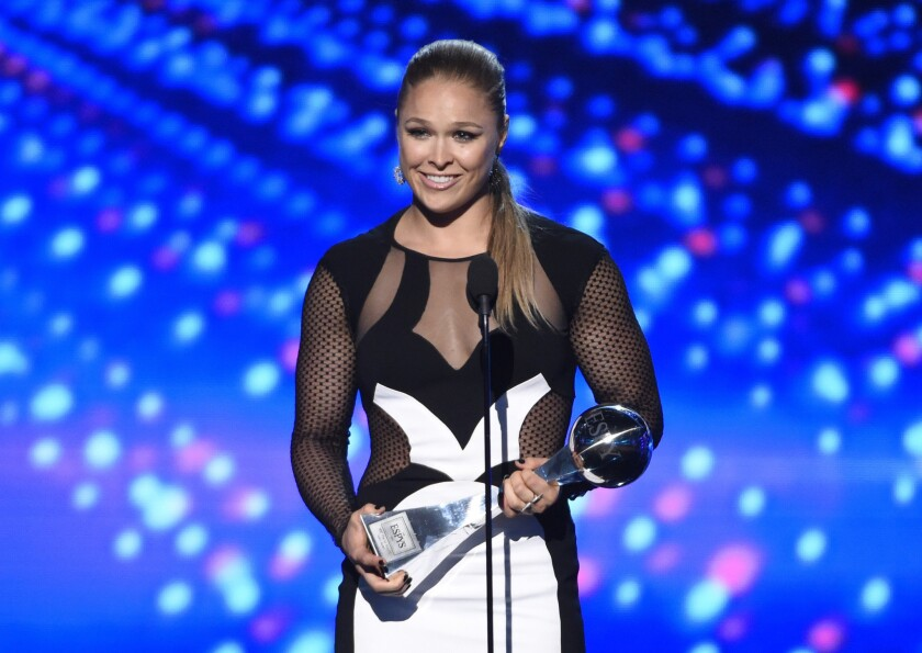 Ronda Rousey accepts the award for best female athlete at the ESPY Awards on Wednesday at the Microsoft Theater in Los Angeles.