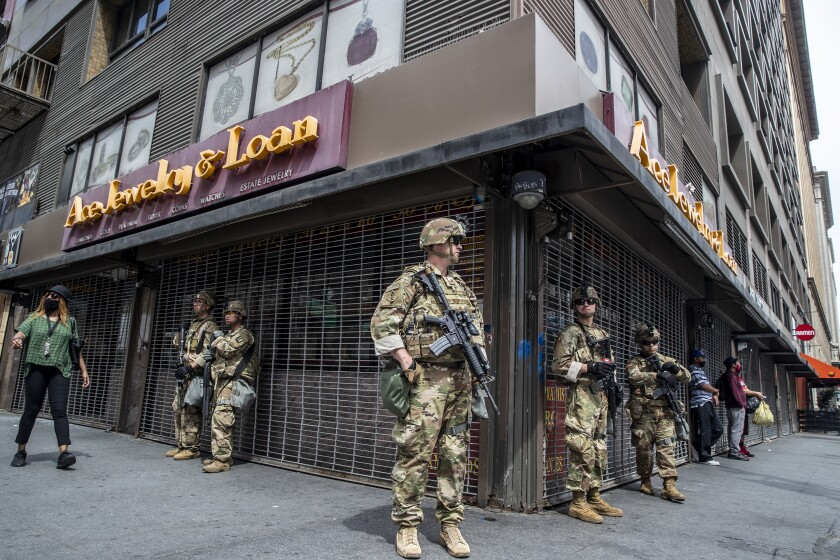 National Guard troops stand watch at 6th and South Hill streets in the heart of L.A.'s Jewelry District.