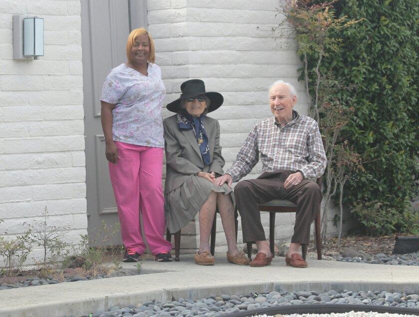 La Jolla residents Dr. John and Lola Ross with Jessica Ellis await Clinton's arrival.