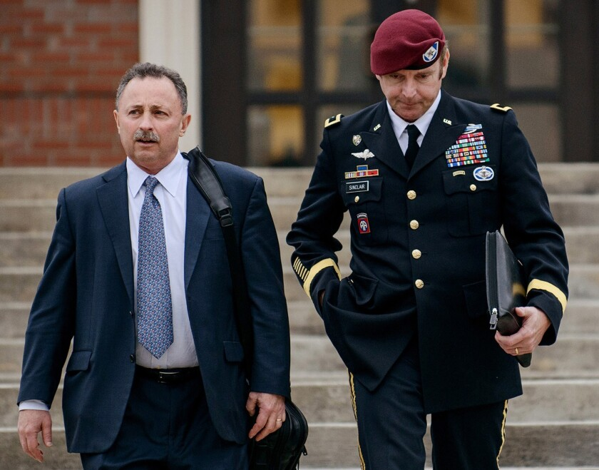 In this March 4 file photo, Brig. Gen. Jeffrey Sinclair, right, leaves the courthouse with a lawyer.