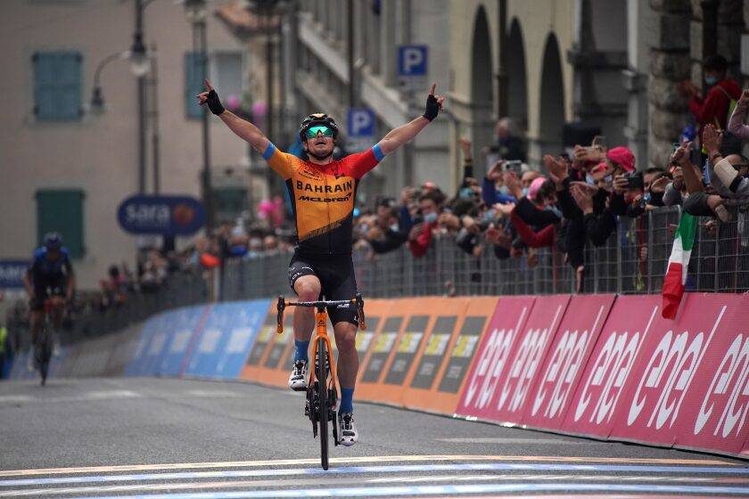 Slovenia's Jan Tratnik celebrates as he wins the 16th stage of the Giro d'Italia cycling race, from Udine to San Daniele del Friuli, Italy, Tuesday, Oct. 20, 2020. (Gian Mattia D'Alberto/LaPresse via AP)