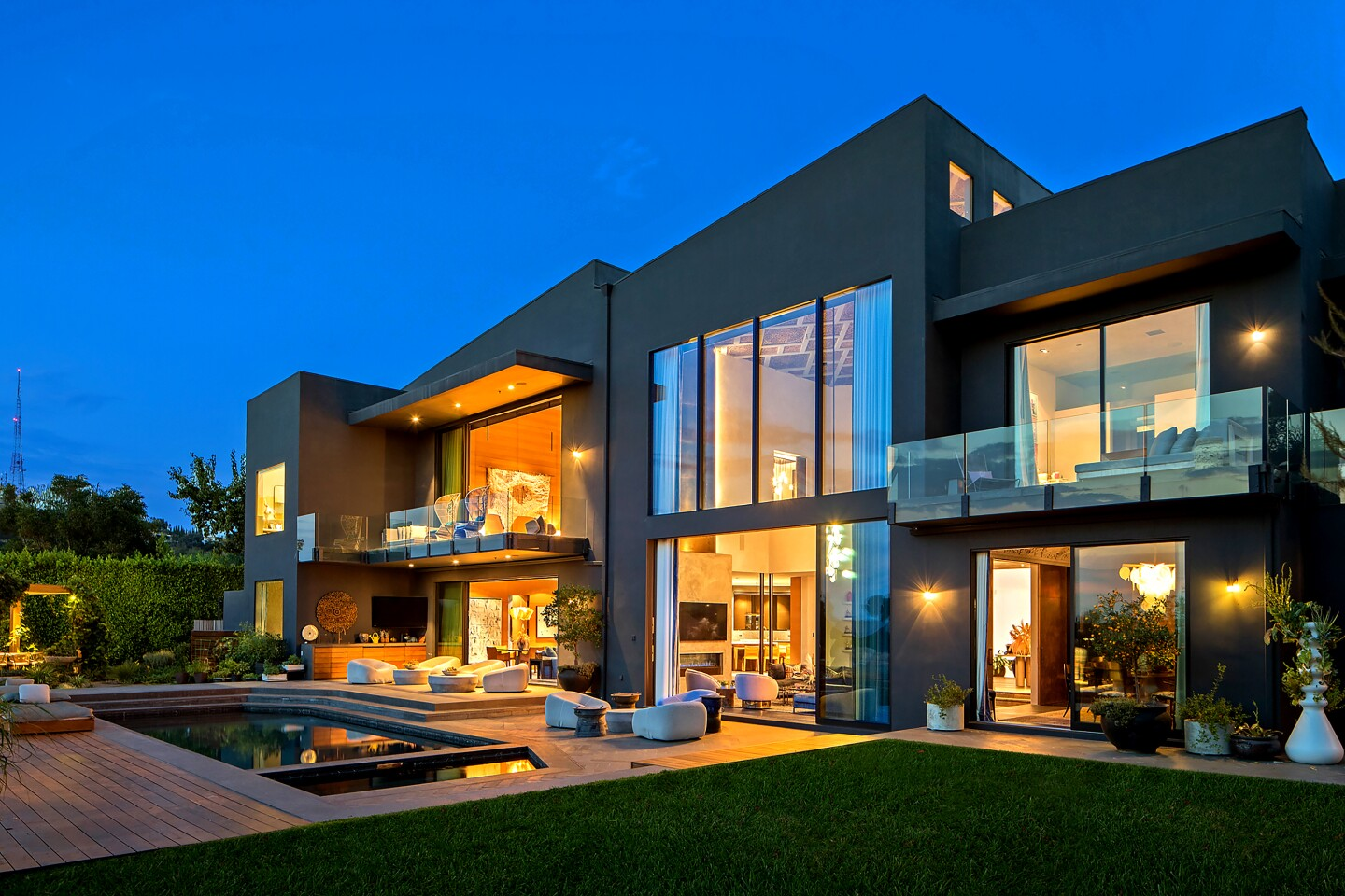 John Legend and Chrissy Teigen, who are expecting their third child, are asking $23.95 million for their contemporary home in the Beverly Hills Post Office area. Once owned by Rihanna, the multilevel house has been updated with cerused oak floors, hot-rolled steel walls and bespoke patterned ceilings from Thailand. Features of Legend and Teigen's home include a movie theater, a gym and a chef's kitchen. Three balconies overlook a saltwater swimming pool.