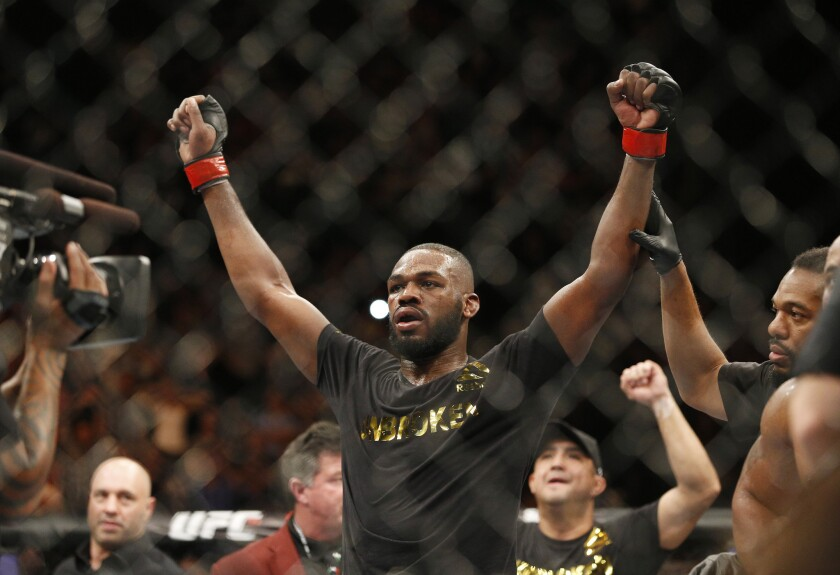 Jon Jones celebrates after defeating Daniel Cormier in a light-heavyweight title bout at UFC 182 on Saturday night in Las Vegas.