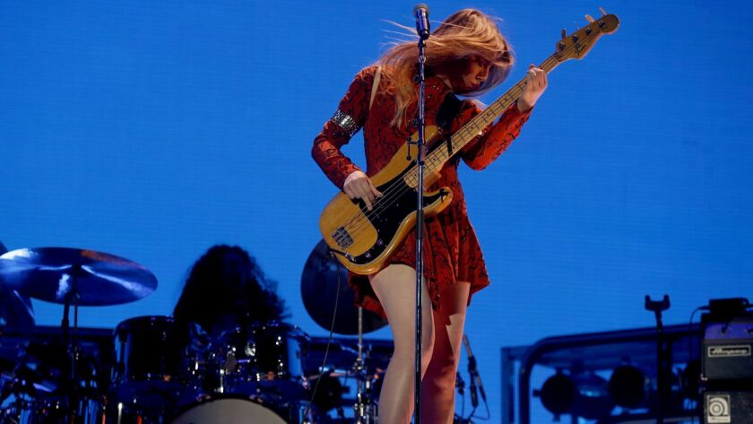 INDIO, CALIF. - APR. 13, 2018. Bassist Este Haim performs with her sisters in the band called Haim