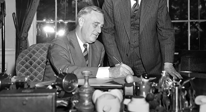 President Franklin D. Roosevelt signs the Works Progress Administration into law  on May 6, 1935. The Federal Writers Project followed on July 27.