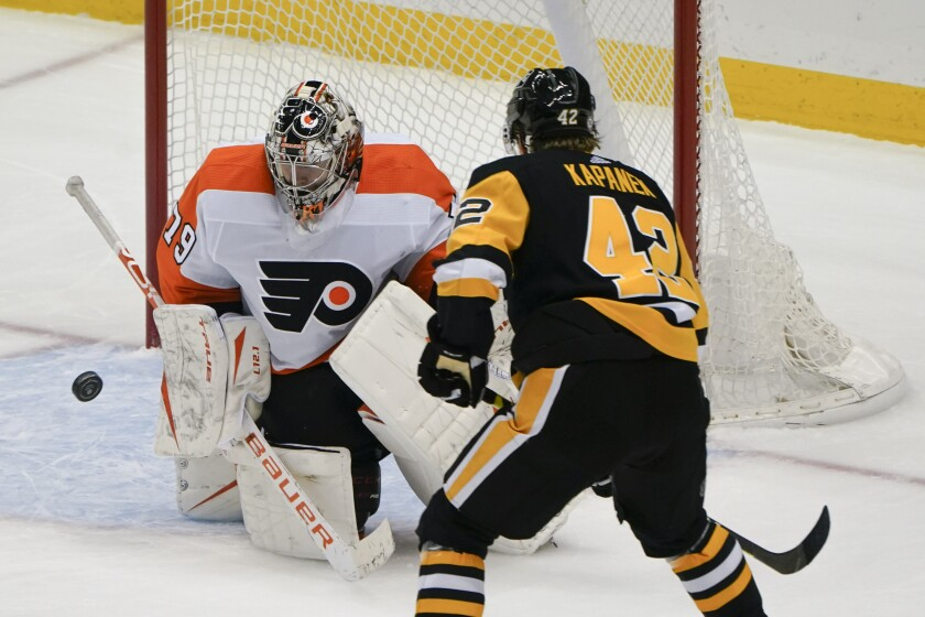 Philadelphia Flyers goaltender Carter Hart (79) stops a shot by Pittsburgh Penguins' Kasperi Kapanen (42) during the third period of an NHL hockey game Tuesday, March 2, 2021, in Pittsburgh. The Penguins won 5-2.(AP Photo/Keith Srakocic)