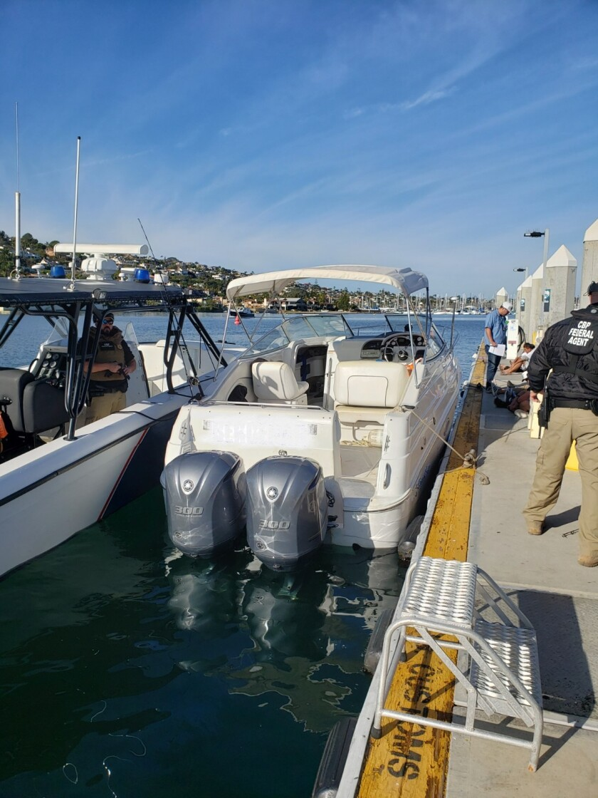 Authorities apprehended 21 people that allegedly crossed into the United States illegally aboard this 25-foot cuddy cabin boat.