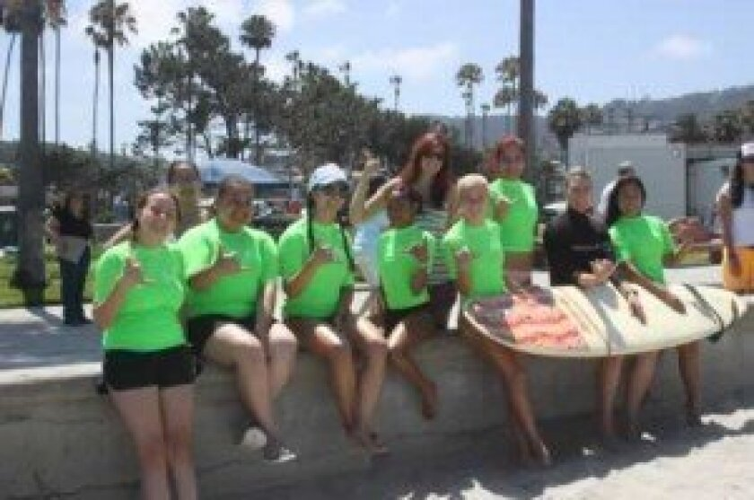 The girls group is ready for some surfing!