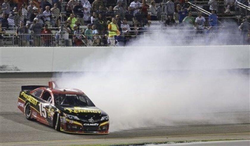 Clint Bowyer gets sideways during the NASCAR Sprint Cup Series auto race at Richmond International Raceway in Richmond, Va., Saturday, Sept. 7, 2013. (AP Photo/Steve Helber)