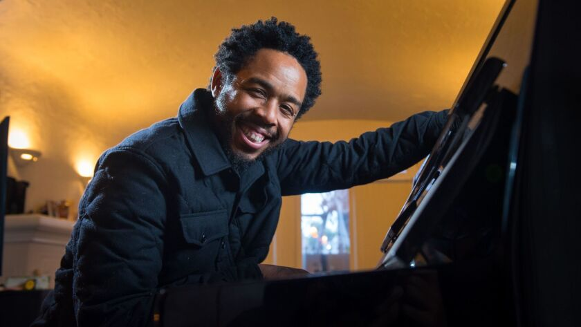 LOS ANGELES, CA - FEBRUARY 6, 2017: Producer and musician Terrace Martin sits at a piano at a house