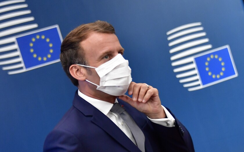 French President Emmanuel Macron arrives for an EU summit at the European Council building in Brussels, Friday, July 17, 2020. Leaders from 27 European Union nations meet face-to-face on Friday for the first time since February, despite the dangers of the coronavirus pandemic, to assess an overall budget and recovery package spread over seven years estimated at some 1.75 trillion to 1.85 trillion euros. (John Thys, Pool Photo via AP)