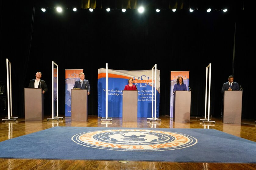 Candidates stand at lecterns before a debate at Virginia State University.