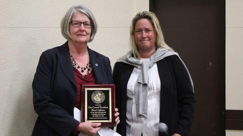 Outgoing City Council President Sherri Lightner receives a plaque from LJCPA president Cindy Greatrex for 'her vision and leadership in shaping and protecting the Village of La Jolla' at the Nov. 3 meeting.