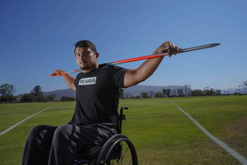 U.S. Paralympian Justin Phongsavanh, 24, poses with his javelin before a workout in Chula Vista.