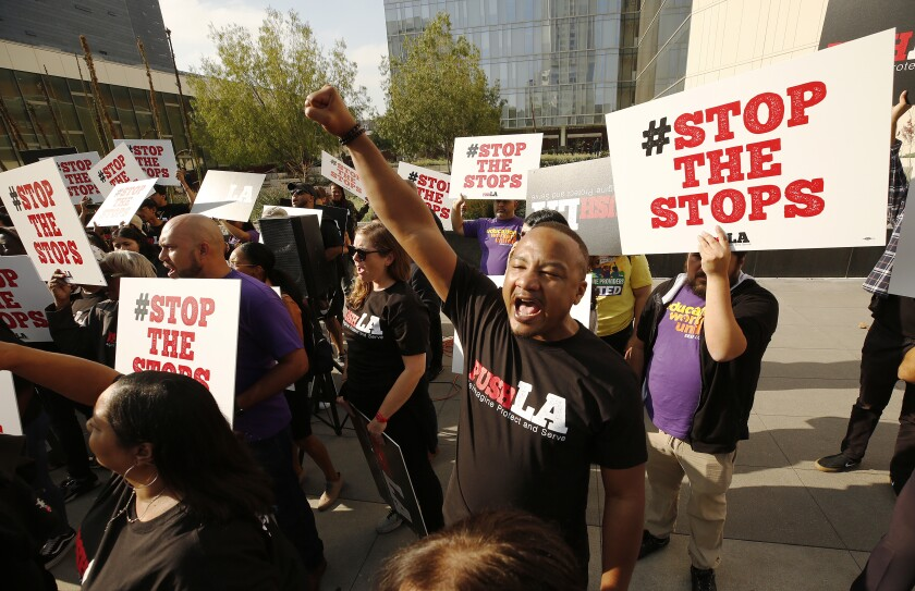 Community groups in front of LAPD headquarters demanding that the department reform its vehicle stop practices, which disproportionately impact blacks and Latinos.