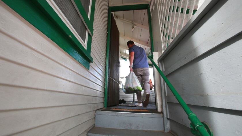 Assembly Bill 1482 could limit how much rents can increase in a year. Pictured: A man enters his apartment in Little Italy.