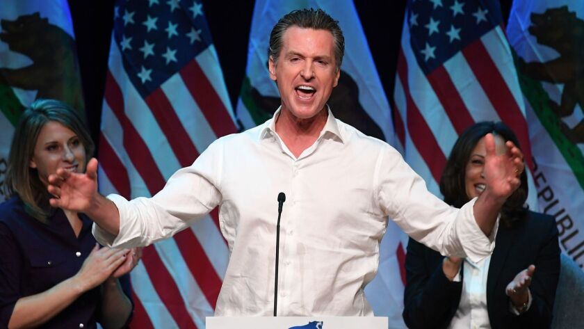 California Gov.-elect Gavin Newsom speaks to the crowd at a campaign rally in Santa Clarita before the midterm election.