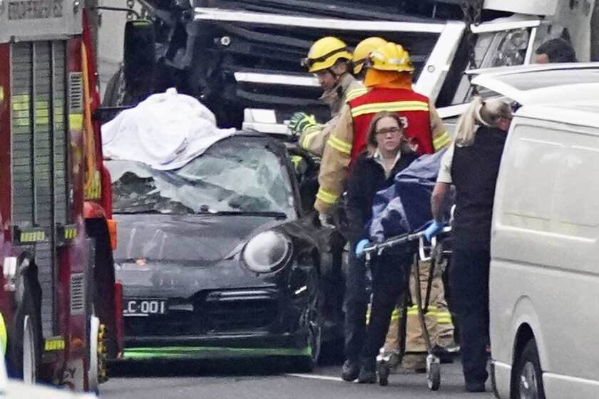 Emergency personnel work at the scene of a collision in Melbourne, Australia, on Thursday, which killed four police officers.