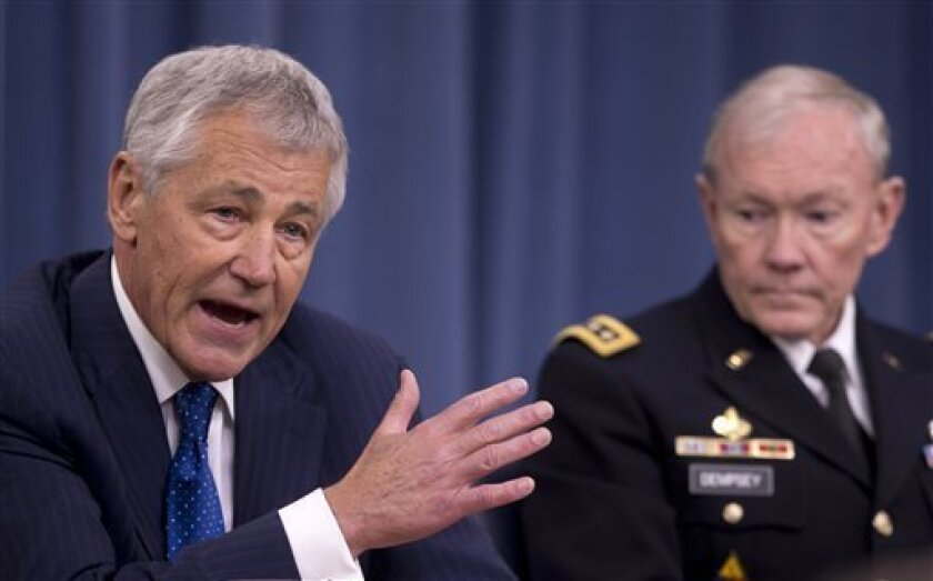 Defense Secretary Chuck Hagel, left, accompanied by Joint Chiefs Chairman Gen. Martin Dempsey, participates in a news conference at the Pentagon, Wednesday, April 10, 2013, about the fiscal year 2014 defense budget. (AP Photo/Carolyn Kaster)