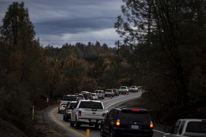 PARADISE, CALIF. - DECEMBER 15: Motor vehicles sit in a queue along Skyway, waiting to gain access t