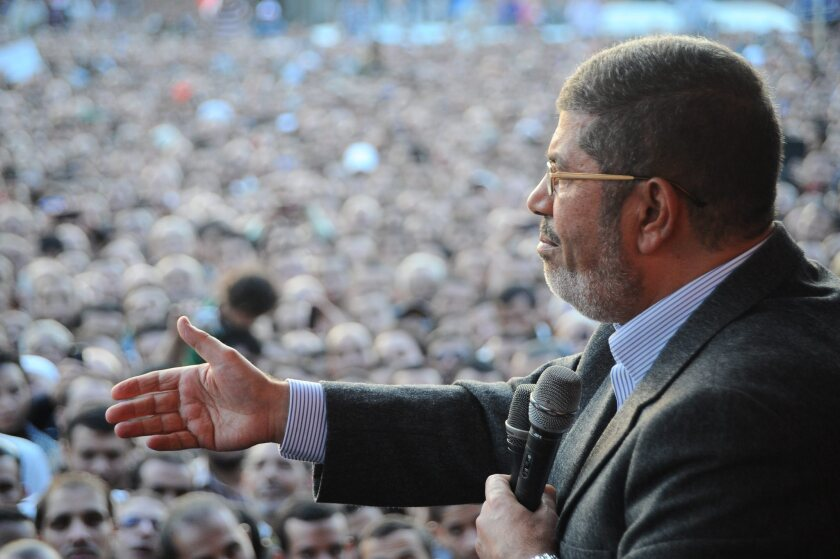 Egyptian President Mohamed Morsi speaks to his supporters next the Presidential palace in Cairo.