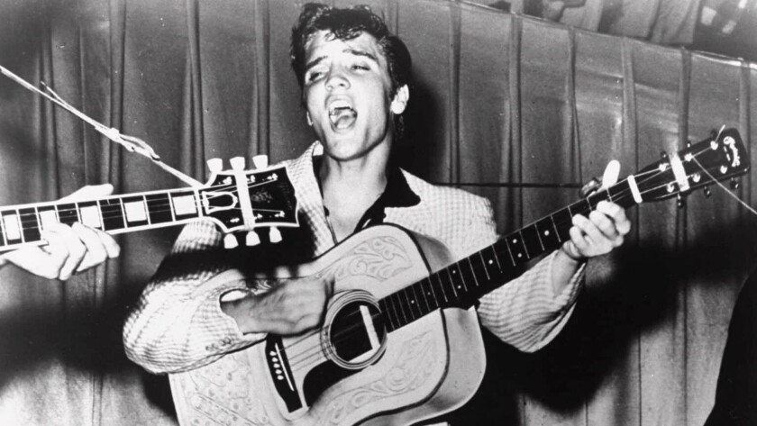 Elvis Presley performing in 1956. This photo was used for his first RCA Victor album cover.