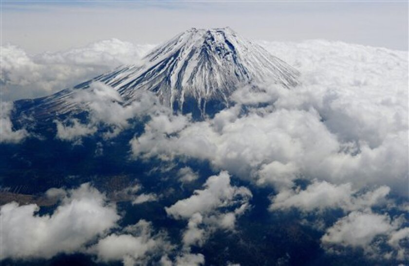 Mt. Fuji is seen from Shizuoka prefecture, central Japan Wednesday, May 1, 2013. Japan's iconic Mt. Fuji will likely win recognition as a World Heritage site. The Agency for Cultural Affairs issued a notice Wednesday saying it had received notification that Mt. Fuji was recommended for World Herita