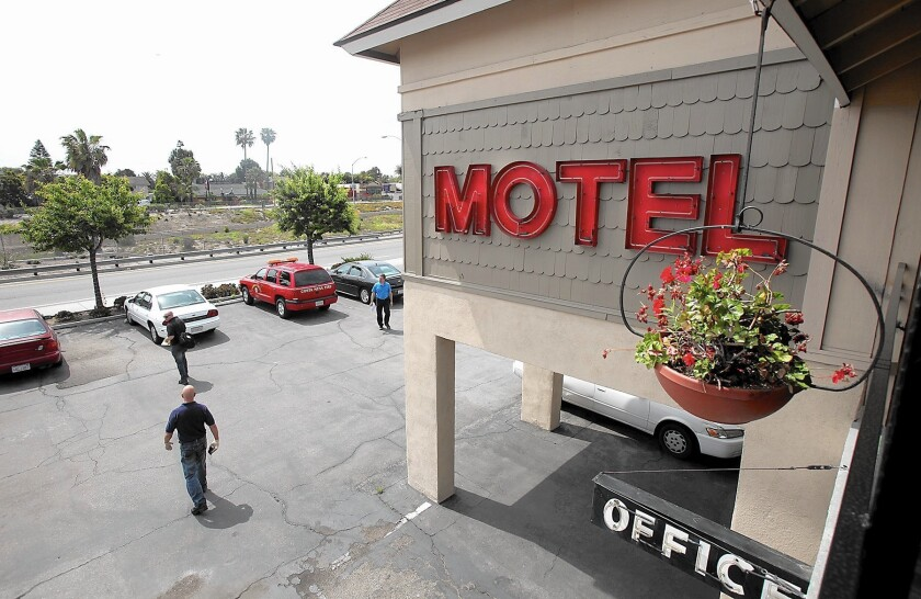 Costa Mesa's ordinance banning most long-term stays at local motels has affected facilities like the Sandpiper Motel on Newport Boulevard.
