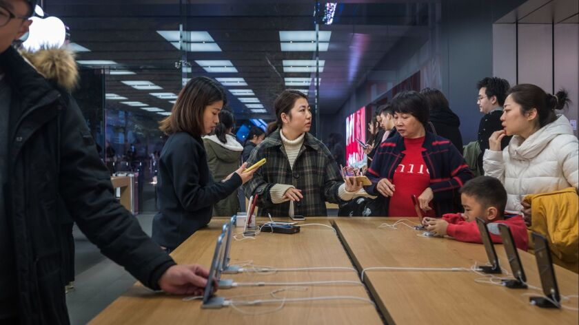 Apple Cuts Revenue Forecast Following Weak Sales In China
