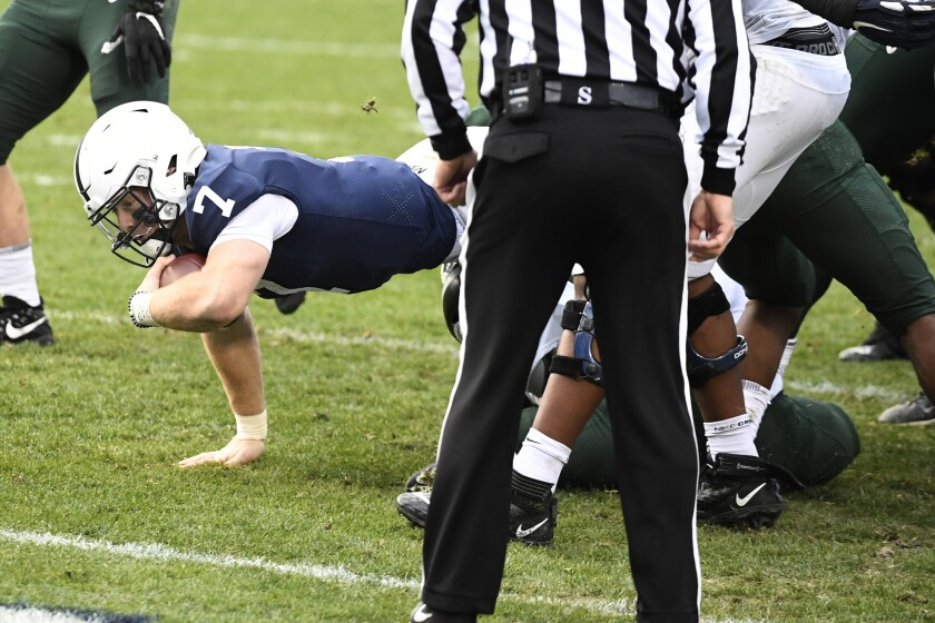 Penn State quarterback Will Levis (7) dives toward the goal line in the third quarter against Michigan State of an NCAA college football game against Michigan State in State College, Pa., on Saturday, Dec. 12, 2020. (AP Photo/Barry Reeger)