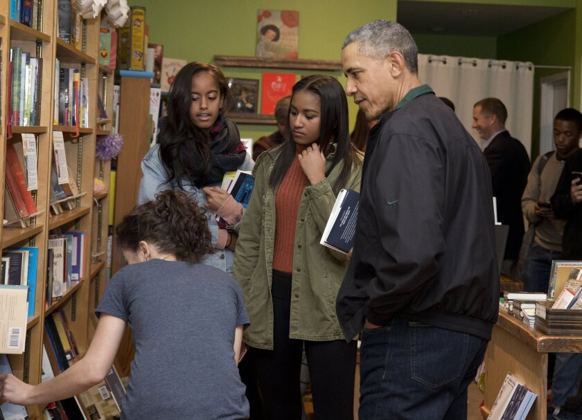 President Obama, right, joined by his daughters Sasha, left, and Malia, center, at Upshur Street Books in Washington, D.C.