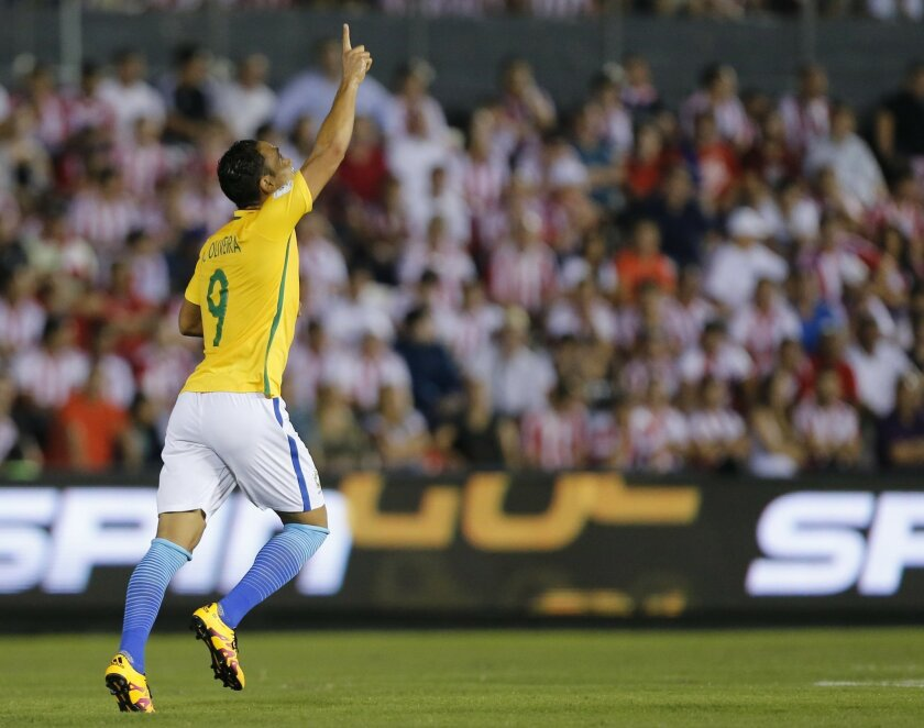 Brazil's Ricardo Olivera celebrates his goal against Paraguay during a World Cup qualifying soccer match in Asuncion, Paraguay Tuesday, March 29, 2016. (AP Photo/Jorge Saenz)