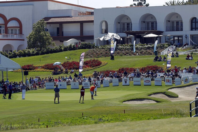 Players putt on the 18th hole during The Celebrity Championship golf tournament held the Omni La Costa Resort & Spa.