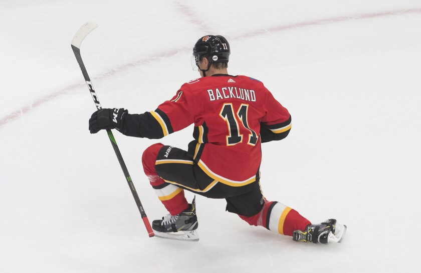 Calgary Flames' Mikael Backlund (11) celebrates a goal against the Winnipeg Jets during the second period of an NHL hockey playoff game Saturday, Aug. 1, 2020 in Edmonton, Alberta. (Jason Franson/The Canadian Press via AP)