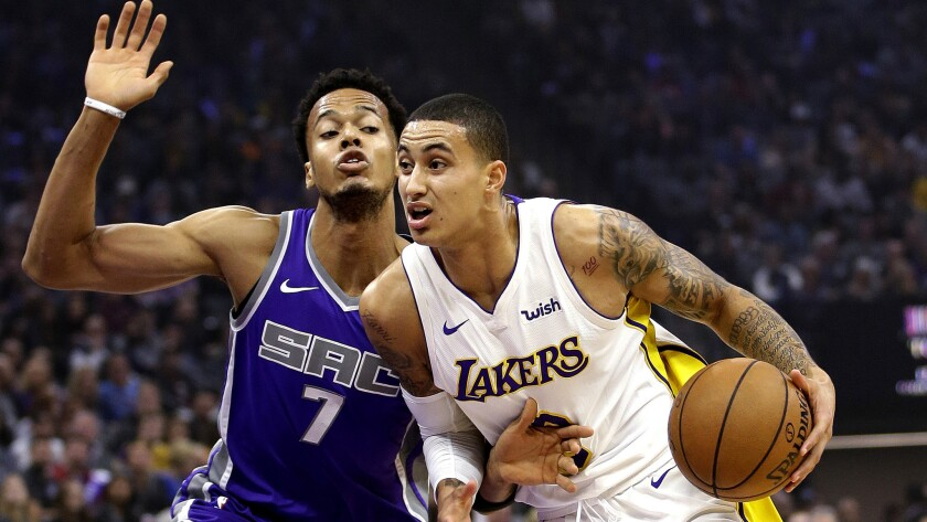Lakers forward Kyle Kuzma drives against Kings forward Skal Labissiere during the first quarter Wednesday night.