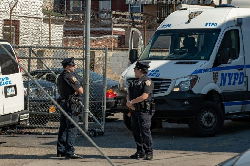 A man was found dead with trauma to his head inside a BMW on Northern Boulevard, Queens on Sunday.