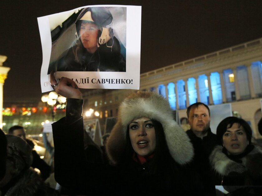 A woman holds a poster of captured Ukrainian army officer Nadezhda Savchenko at a rally in Kiev on Jan. 26.