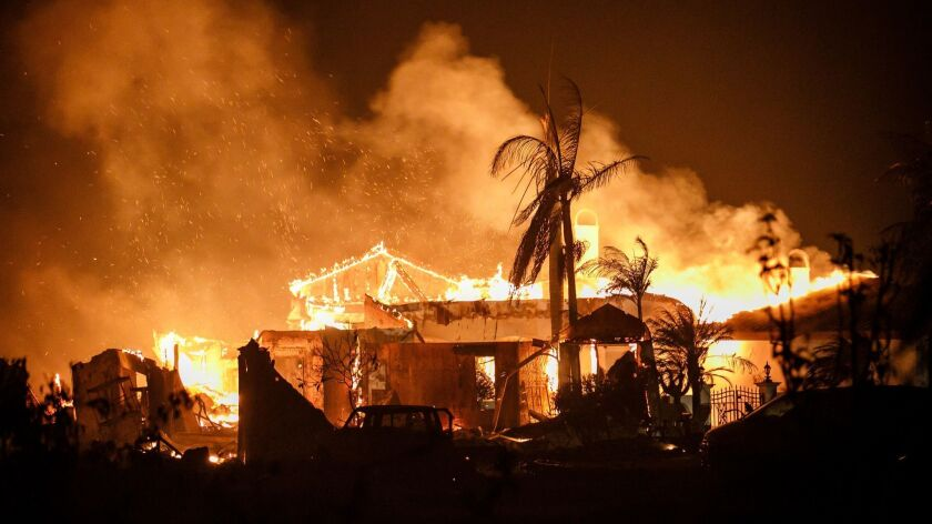 Firefighters work to contain a structure fire in Goleta, Calif.