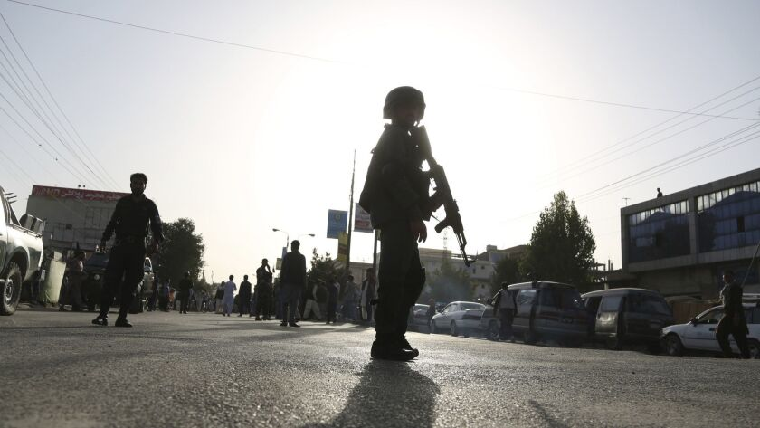 Security personnel arrived at the site of a deadly suicide bombing that targeted a training class in