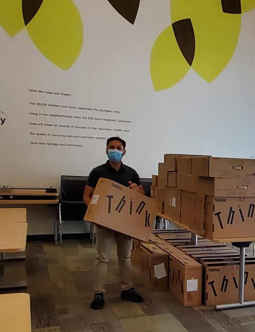 Mesa Water District partnered with IT firm T2 Tech Group to donate 70 computers to area children's charities