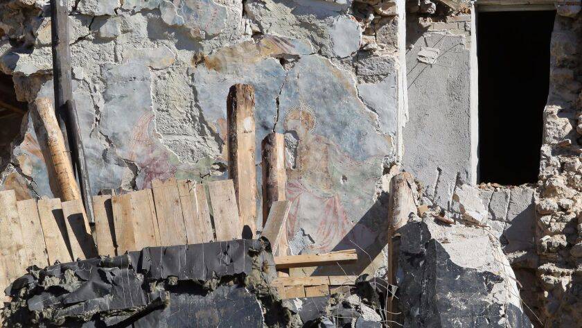 The rubble of the destroyed church of San Salvatore in Campi di Norcia in Italy, home to important 15th century frescoes.