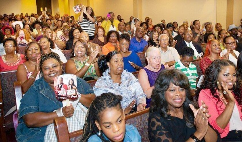 """A crowd gathers at First AME for a screening of the new TV sitcom """"The Soul Man,"""" with star Cedric the Entertainer and other actors in attendance."""