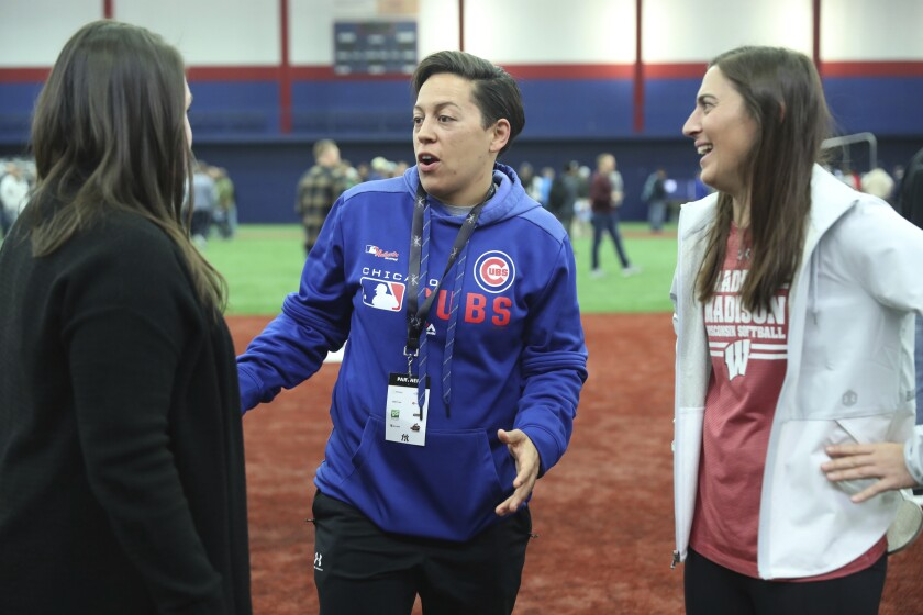 Chicago Cubs minor league hitting coach Rachel Folden, center, talks with colleagues during a hitting clinic at the University of Illinois at Chicago, Saturday, Nov. 23, 2019. None of the players care all that much that one of their coaches is a woman. The girls she encounters, they care very much that one of the coaches is a woman. (John J. Kim/Chicago Tribune via AP)