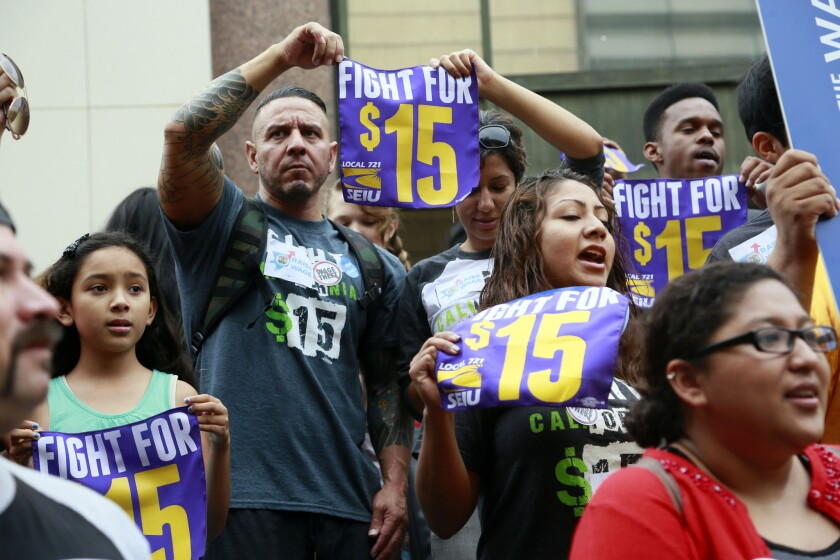 Workers last July rally in Los Angeles in support of raising the minimum wage.