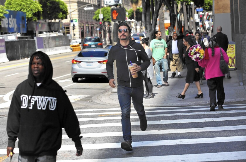 Some of the newer residents of downtown are unhappy with the LAPD's traffic enforcement -- don't think you won't get a ticket if you enter the crosswalk after the red hand starts flashing and the countdown has begun -- and they have tickets to prove it.
