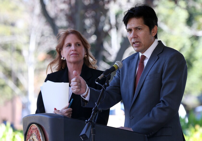 State Sen. Noreen Evans (D-Santa Rosa), left, looks on as state Sen. Kevin de Leon (D-Los Angeles) speaks during a news conference on guns last year. Evans is being replaced as chairwoman of the Judiciary Committee.