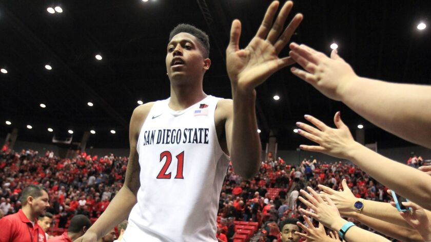 The Aztecs' Malik Pope greets fans after the game against UNLV on March 5 at Viejas Arena.