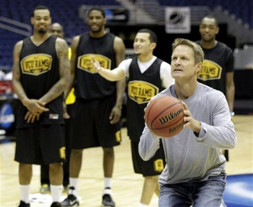Former NBA player Steve Kerr participates in a shooting contest with members of the VCU team during a practice for a Southwest regional semifinal game in the NCAA college basketball tournament Thursday March 24, 2011, in San Antonio. VCU plays Florida St. on Friday (AP Photo/Tony Gutierrez)