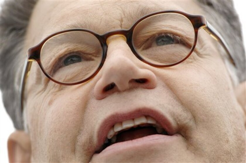 Sen.-elect Al Franken, D-Minn. speaks to supporters during a rally at the mall of the Minnesota State Capitol in St Paul, Minn., Wednesday, July 1, 2009. (AP Photo/Craig Lassig)