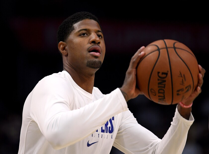 Clippers forward Paul George works on his shot before a game earlier this season.